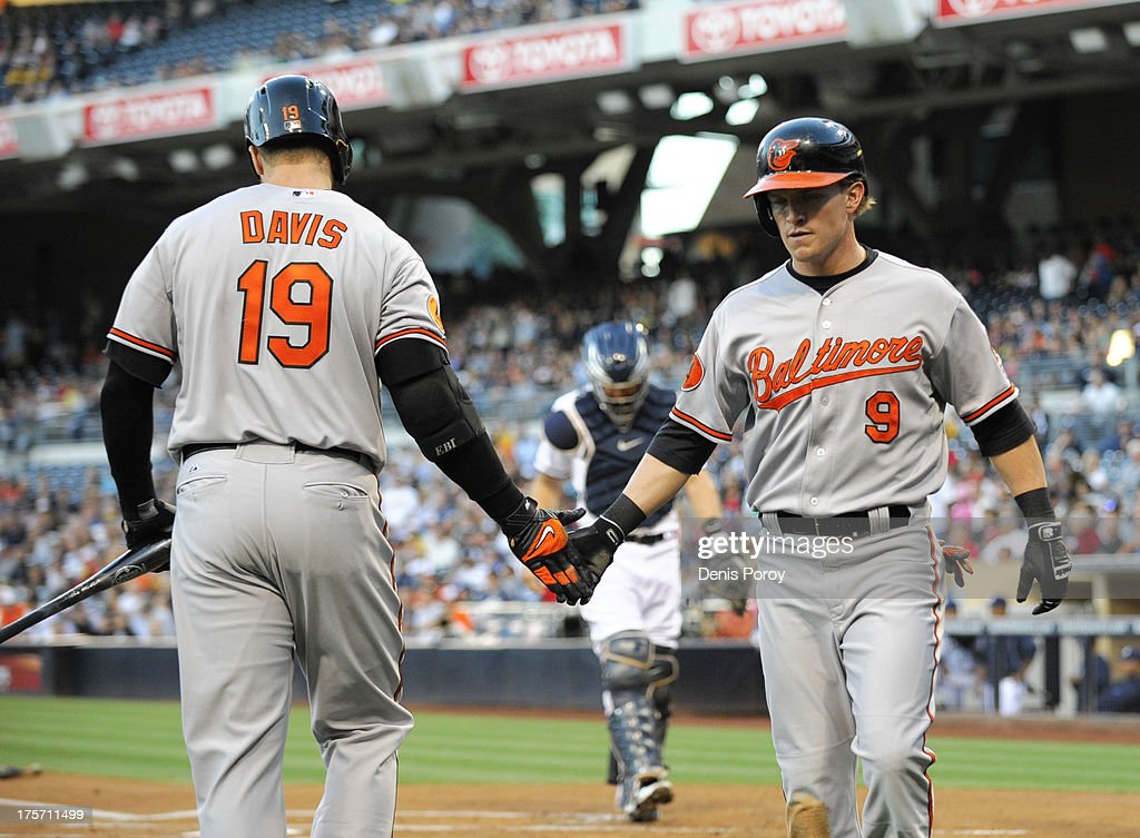 <a gi-track='captionPersonalityLinkClicked' href=/galleries/search?phrase=Nate+McLouth&family=editorial&specificpeople=536572 ng-click='$event.stopPropagation()'>Nate McLouth</a> #9 of the Baltimore Orioles is congratulated by Chris Davis #19 after scoring during the first inning of a baseball game against the San Diego Padres at Petco Park on August 6, 2013 in San Diego, California.