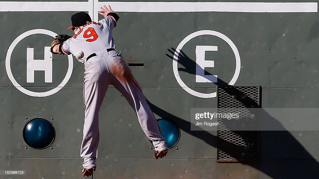 <a gi-track='captionPersonalityLinkClicked' href=/galleries/search?phrase=Nate+McLouth&family=editorial&specificpeople=536572 ng-click='$event.stopPropagation()'>Nate McLouth</a> #9 of the Baltimore Orioles is unable to catch a one-run double hit by Scott Podsednik #26 of the Boston Red Sox in the eighth inning at Fenway Park on September 22, 2012 in Boston, Massachusetts.