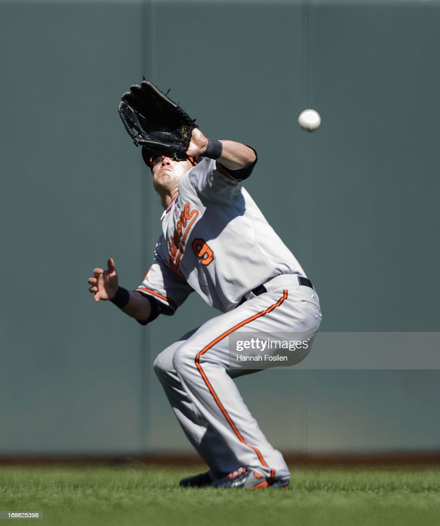 <a gi-track='captionPersonalityLinkClicked' href=/galleries/search?phrase=Nate+McLouth&family=editorial&specificpeople=536572 ng-click='$event.stopPropagation()'>Nate McLouth</a> #9 of the Baltimore Orioles looses the baseball hit by Joe Mauer #7 of the Minnesota Twins in the sun during the eighth inning of the game on May 12, 2013 at Target Field in Minneapolis, Minnesota. The Orioles defeated the Twins 6-0.