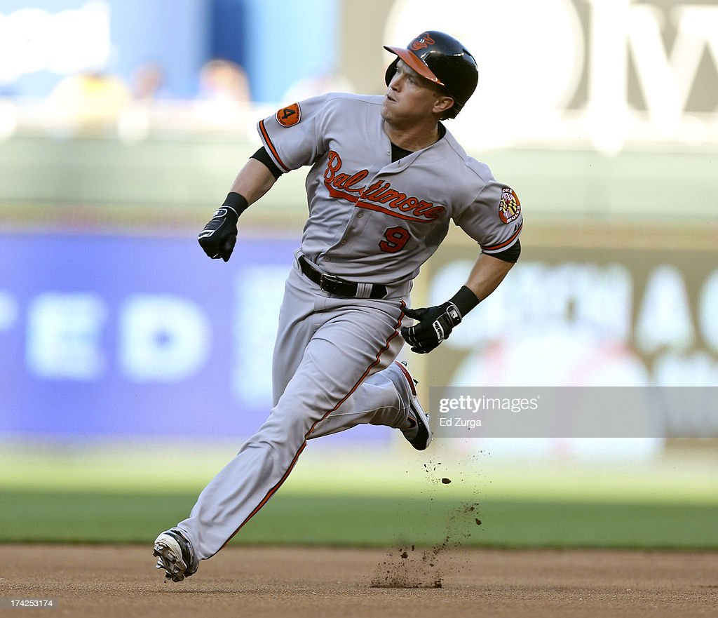 <a gi-track='captionPersonalityLinkClicked' href=/galleries/search?phrase=Nate+McLouth&family=editorial&specificpeople=536572 ng-click='$event.stopPropagation()'>Nate McLouth</a> #9 of the Baltimore Orioles runs the bases as he heads home to score on an error by Mike Moustakas of the Kansas City Royals who was trying to field a hit by Manny Machado in the first inning at Kauffman Stadium on July 22, 2013 in Kansas City, Missouri.