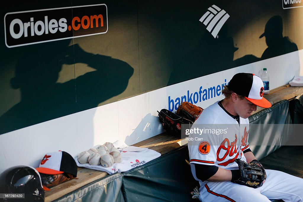 Nate McLouth #9 of the Baltimore Orioles sits in the dugout before taking the field against the Toronto Blue Jays at Oriole Park at Camden Yards on April 23, 2013 in Baltimore, Maryland.