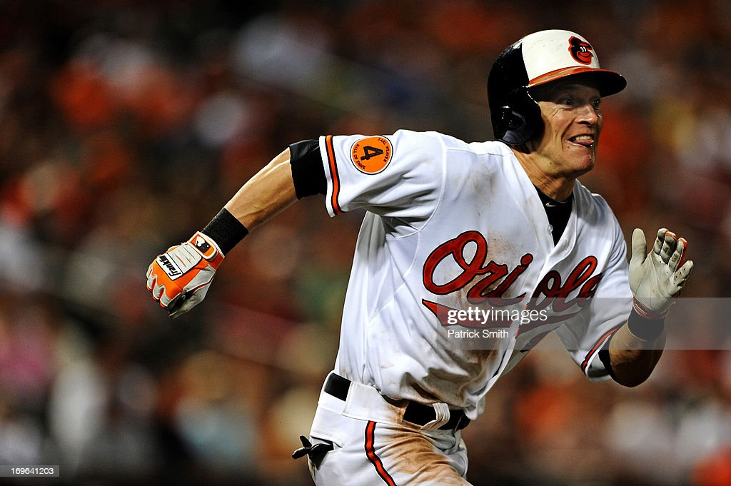 <a gi-track='captionPersonalityLinkClicked' href=/galleries/search?phrase=Nate+McLouth&family=editorial&specificpeople=536572 ng-click='$event.stopPropagation()'>Nate McLouth</a> #9 of the Baltimore Orioles sprints to first base, where he was safe on the play, against the Washington Nationals in the eighth inning during an interleague game at Oriole Park at Camden Yards on May 29, 2013 in Baltimore, Maryland. The Baltimore Orioles won, 9-6.