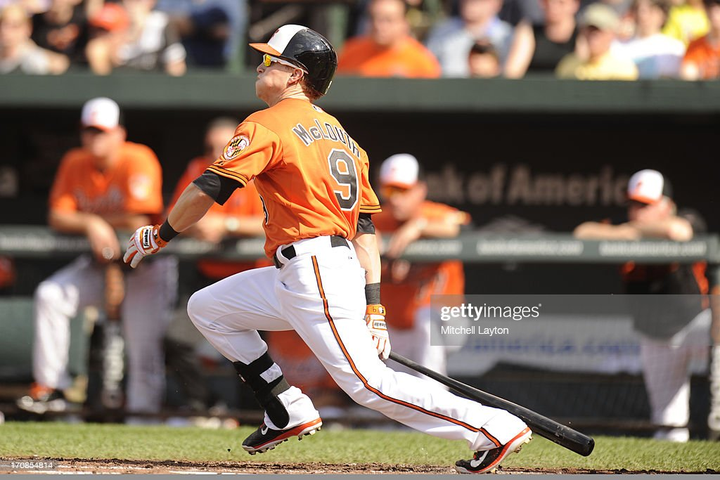 <a gi-track='captionPersonalityLinkClicked' href=/galleries/search?phrase=Nate+McLouth&family=editorial&specificpeople=536572 ng-click='$event.stopPropagation()'>Nate McLouth</a> #9 of the Baltimore Orioles takes a swing during a baseball game against the Boston Red Sox on June 15, 2013 at Oriole Park at Camden Yards in Baltimore, Maryland. The Red Sox won 5-4.