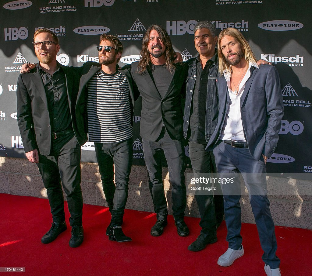 Nate Mendel, Chris Shiflett, Dave Grohl, Pat Smear and Taylor Hawkins of Foo Fighters attend the 30th Annual Rock And Roll Hall Of Fame Induction Ceremony at Public Hall on April 18, 2015 in Cleveland, Ohio.