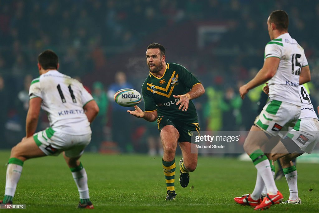 <a gi-track='captionPersonalityLinkClicked' href=/galleries/search?phrase=Nate+Myles&family=editorial&specificpeople=546460 ng-click='$event.stopPropagation()'>Nate Myles</a> (C) of Australia offloads during the Rugby League World Cup Group A match between Australia and Ireland at Thomond Park on November 9, 2013 in Limerick, .