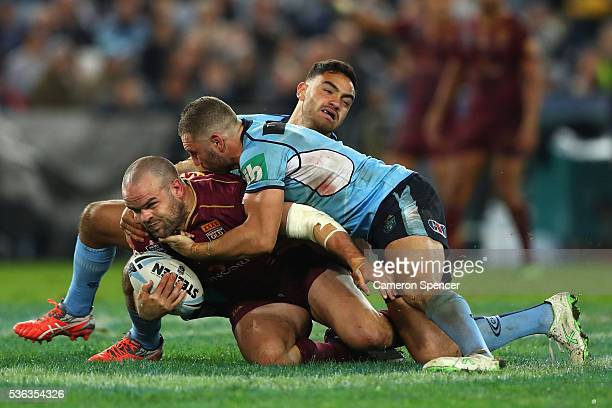 Nate Myles of the Maroons is tackled during game one of the State Of Origin series between the New South Wales Blues and the Queensland Maroons at...