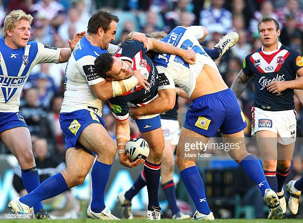 Nate Myles of the Roosters looks to offload during the round 19 NRL match between the Sydney Roosters and the Canterbury Bulldogs at the Sydney...