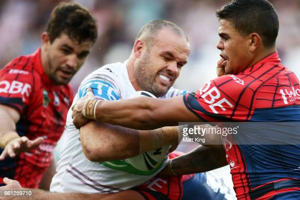 Nate Myles of the Sea Eagles is tackled during the round five NRL match between the Sydney Roosters and the Manly Sea Eagles at Allianz Stadium on...