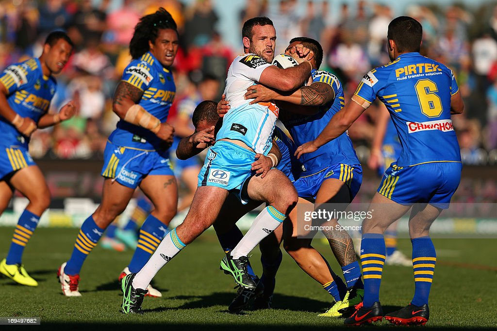 <a gi-track='captionPersonalityLinkClicked' href=/galleries/search?phrase=Nate+Myles&family=editorial&specificpeople=546460 ng-click='$event.stopPropagation()'>Nate Myles</a> of the Titans is tackled during the round 11 NRL match between the Parramatta Eels and the Gold Coast Titans at Glen Willow Regional Sports Stadium on May 26, 2013 in Mudgee, Australia.