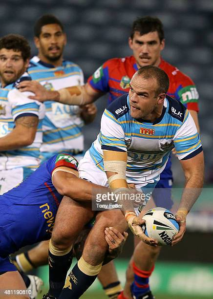 Nate Myles of the Titans is tackled during the round 19 NRL match between the Newcastle Knights and the Gold Coast Titans at Hunter Stadium on July...
