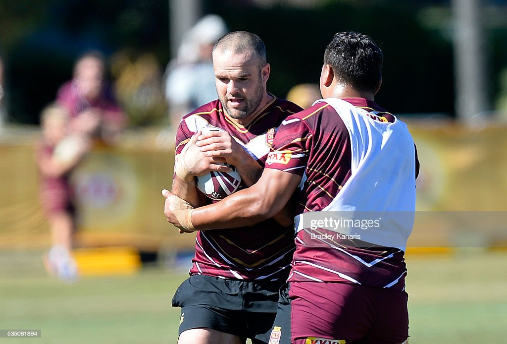<a gi-track='captionPersonalityLinkClicked' href=/galleries/search?phrase=Nate+Myles&family=editorial&specificpeople=546460 ng-click='$event.stopPropagation()'>Nate Myles</a> takes on the defence during a Queensland Maroons State of Origin training session on May 29, 2016 in Gold Coast, Australia.