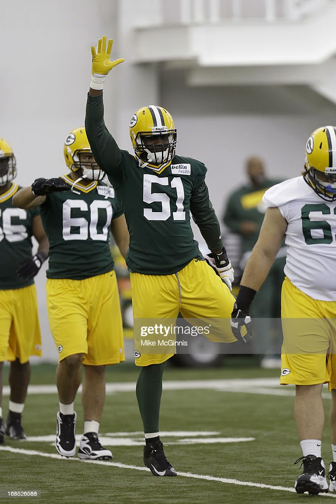 Nate Palmer #51 of the Green Bay Packers runs through some warm ups before the start of rookie camp at the Don Hutson Center on May 10, 2013 in Green Bay, Wisconsin.