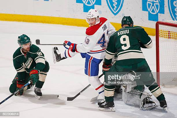Nate Prosser Mikko Koivu and goalie Darcy Kuemper of the Minnesota Wild defend their goal against Daniel Carr of the Montreal Canadiens during the...