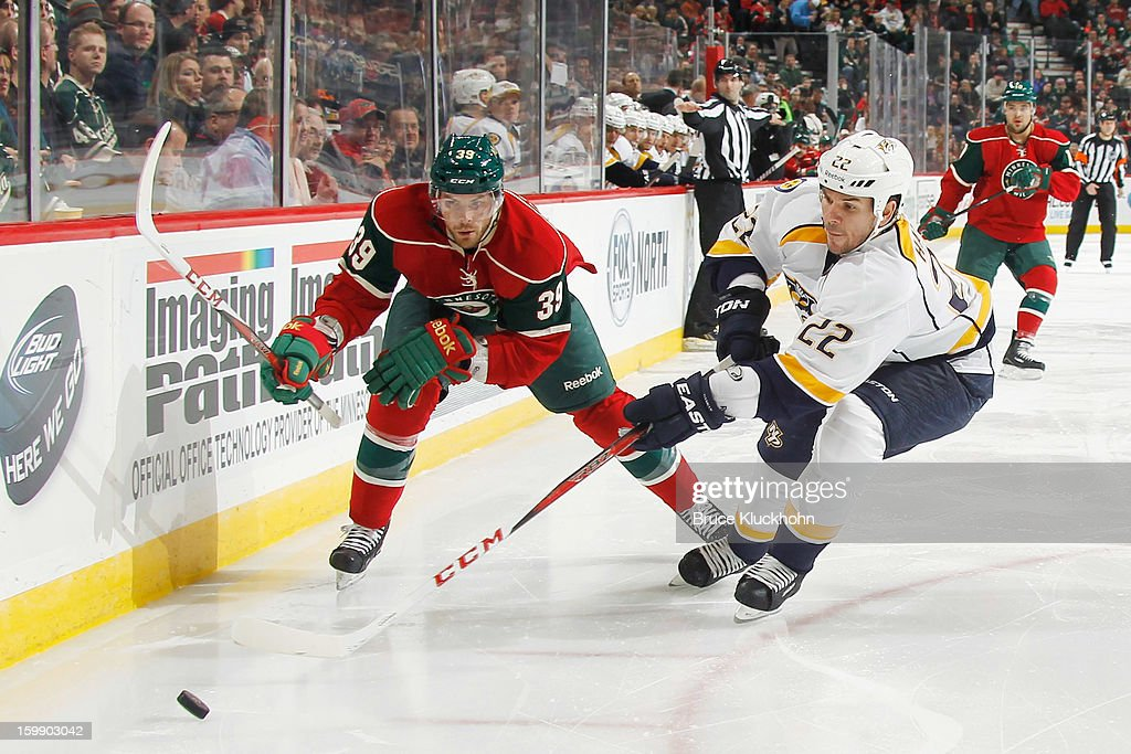 Nate Prosser #39 of the Minnesota Wild and <a gi-track='captionPersonalityLinkClicked' href=/galleries/search?phrase=Scott+Hannan&family=editorial&specificpeople=203195 ng-click='$event.stopPropagation()'>Scott Hannan</a> #22 of the Nashville Predators skate to the puck during the game on January 22, 2013 at the Xcel Energy Center in Saint Paul, Minnesota.