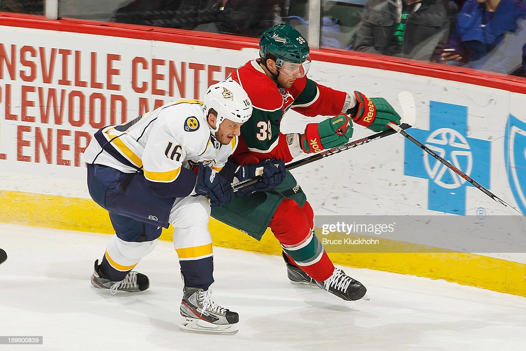 Nate Prosser #39 of the Minnesota Wild handles the puck with Rich Clune #16 of the Nashville Predators defending during the game on January 22, 2013 at the Xcel Energy Center in Saint Paul, Minnesota.