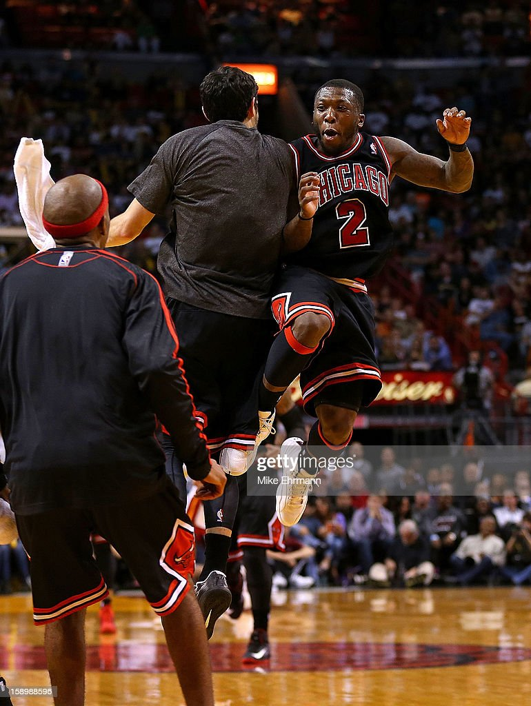 Nate Robinson #2 and Kirk Hinrich #12 of the Chicago Bulls celebrate during a game against the Miami Heat at AmericanAirlines Arena on January 4, 2013 in Miami, Florida.