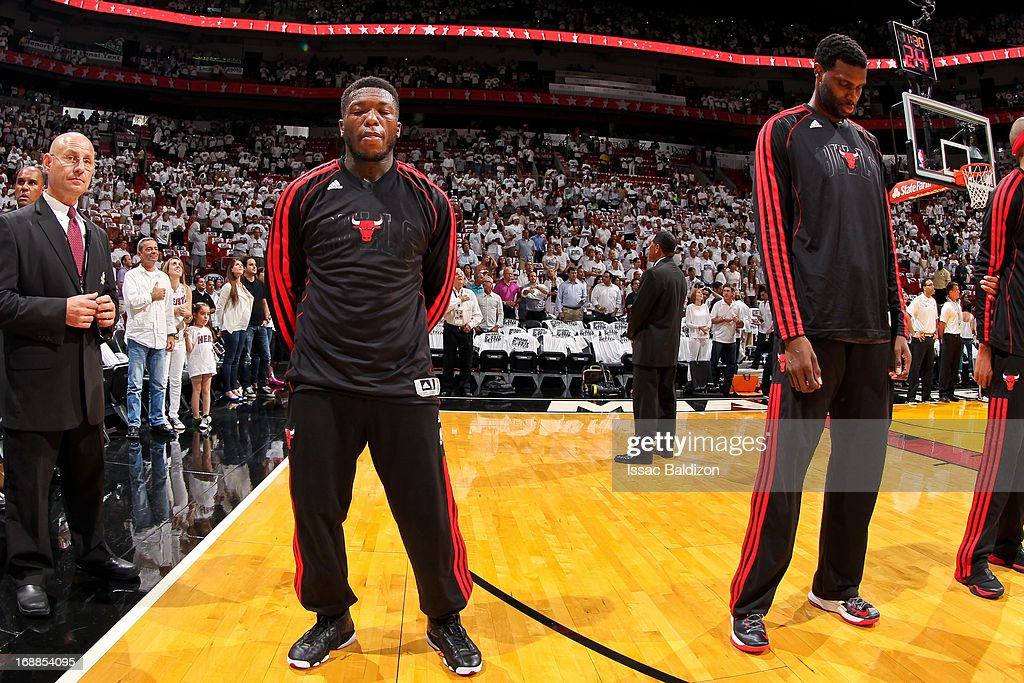 Nate Robinson #2 and Nazr Mohammed #48 of the Chicago Bulls listen to the National Anthem before playing against the Miami Heat in Game Five of the Eastern Conference Semifinals during the 2013 NBA Playoffs on May 15, 2013 at American Airlines Arena in Miami, Florida.