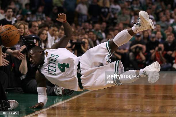 Nate Robinson of the Boston Celltics falls out of bounds going after a loose ball in the fourth quarter against the Los Angeles Lakers during Game...