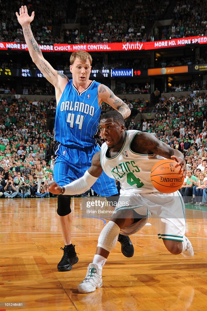 Nate Robinson #4 of the Boston Celtics drives the lane against Jason Williams #44 of the Orlando Magic in Game Six of the Eastern Conference Finals during the 2010 NBA Playoffs at TD Garden on May 28, 2010 in Boston, Massachusetts.