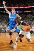 Nate Robinson of the Boston Celtics drives the lane against Jason Williams of the Orlando Magic in Game Six of the Eastern Conference Finals during...