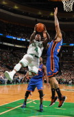 Nate Robinson of the Boston Celtics drives to the basket against Tyson Chandler of the New York Knicks on October 29 2010 at the TD Garden in Boston...