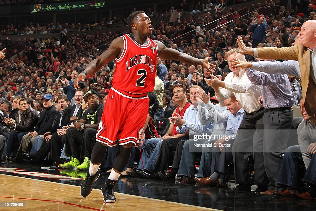 Nate Robinson #2 of the Chicago Bulls acknowledges the crowd following a basket in the game against the Miami Heat on March 27, 2013 at the United Center in Chicago, Illinois.