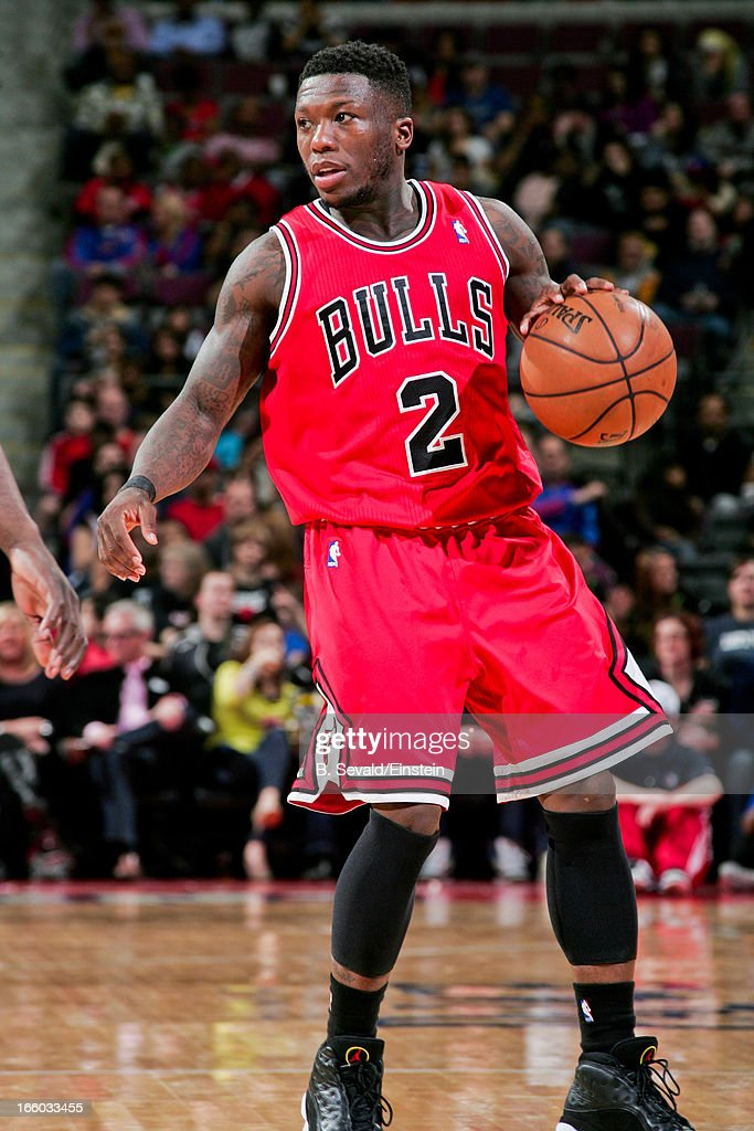 <a gi-track='captionPersonalityLinkClicked' href=/galleries/search?phrase=Nate+Robinson&family=editorial&specificpeople=208906 ng-click='$event.stopPropagation()'>Nate Robinson</a> #2 of the Chicago Bulls advances the ball against the Detroit Pistons on April 7, 2013 at The Palace of Auburn Hills in Auburn Hills, Michigan.