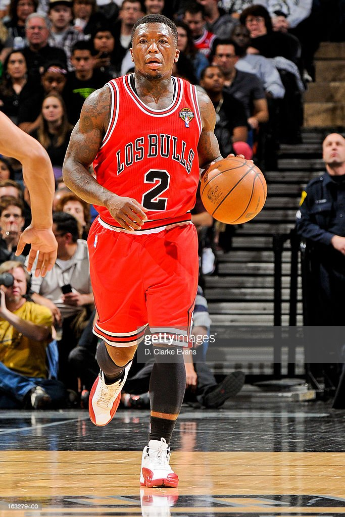 Nate Robinson #2 of the Chicago Bulls advances the ball against the San Antonio Spurs on March 6, 2013 at the AT&T Center in San Antonio, Texas.