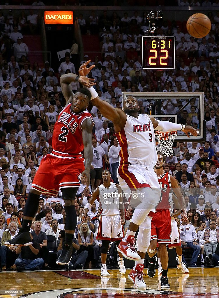 Nate Robinson #2 of the Chicago Bulls and Dwyane Wade #3 of the Miami Heat fight for a loose ball during Game Two of the Eastern Conference Semifinals of the 2013 NBA Playoffs at American Airlines Arena on May 8, 2013 in Miami, Florida.