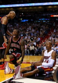 Nate Robinson of the Chicago Bulls and Ray Allen of the Miami Heat react to a play during a game at AmericanAirlines Arena on January 4 2013 in Miami...