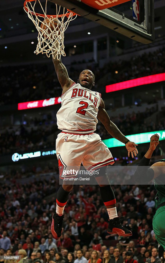 <a gi-track='captionPersonalityLinkClicked' href=/galleries/search?phrase=Nate+Robinson&family=editorial&specificpeople=208906 ng-click='$event.stopPropagation()'>Nate Robinson</a> #2 of the Chicago Bulls attempts a dunk against the Boston Celtics at the United Center on December 18, 2012 in Chicago, Illinois. The Bulls defeated the Celtics 100-89.