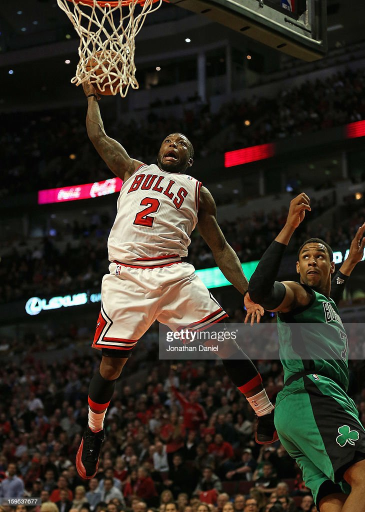 <a gi-track='captionPersonalityLinkClicked' href=/galleries/search?phrase=Nate+Robinson&family=editorial&specificpeople=208906 ng-click='$event.stopPropagation()'>Nate Robinson</a> #2 of the Chicago Bulls attempts a dunk over <a gi-track='captionPersonalityLinkClicked' href=/galleries/search?phrase=Jared+Sullinger&family=editorial&specificpeople=6866665 ng-click='$event.stopPropagation()'>Jared Sullinger</a> #7 of the Boston Celtics at the United Center on December 18, 2012 in Chicago, Illinois. The Bulls defeated the Celtics 100-89.