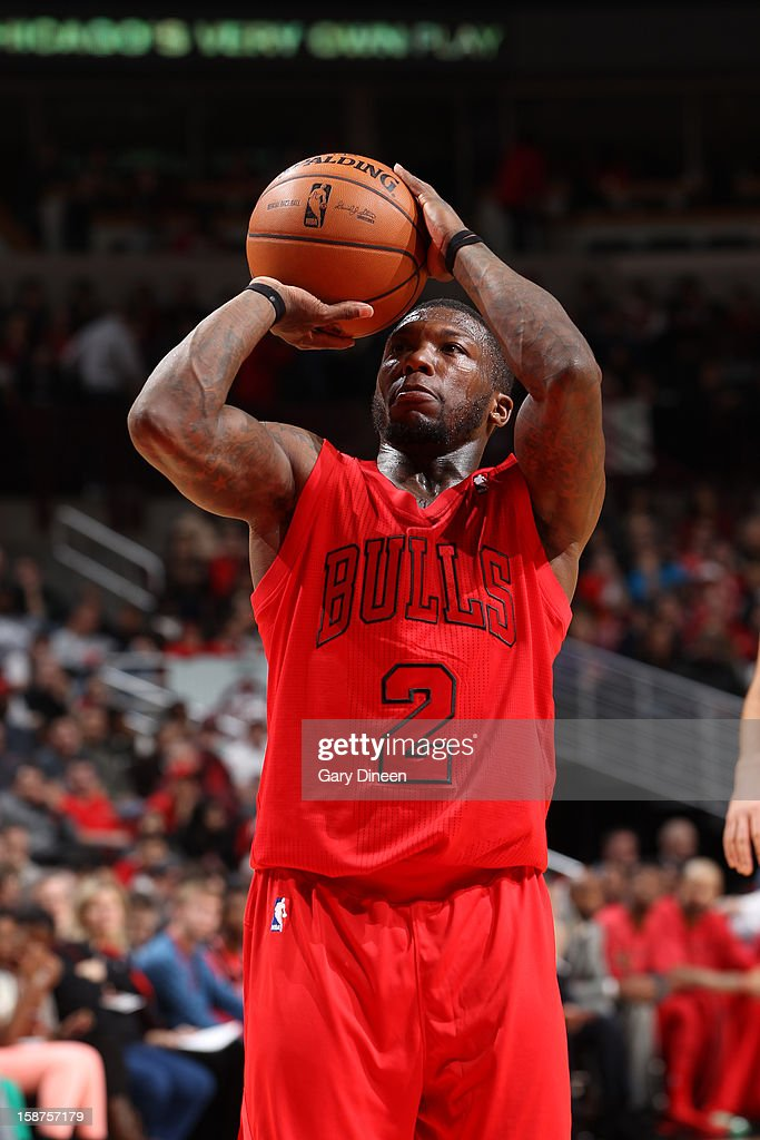 <a gi-track='captionPersonalityLinkClicked' href=/galleries/search?phrase=Nate+Robinson&family=editorial&specificpeople=208906 ng-click='$event.stopPropagation()'>Nate Robinson</a> #2 of the Chicago Bulls attempts a foul shot against the Houston Rockets during a Christmas Day game on December 25, 2012 at the United Center in Chicago, Illinois.