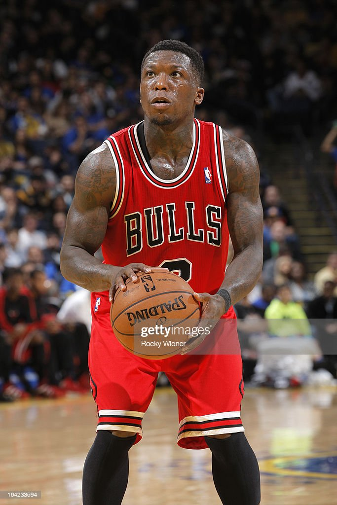 <a gi-track='captionPersonalityLinkClicked' href=/galleries/search?phrase=Nate+Robinson&family=editorial&specificpeople=208906 ng-click='$event.stopPropagation()'>Nate Robinson</a> #2 of the Chicago Bulls attempts a free throw against the Golden State Warriors on March 15, 2013 at Oracle Arena in Oakland, California.
