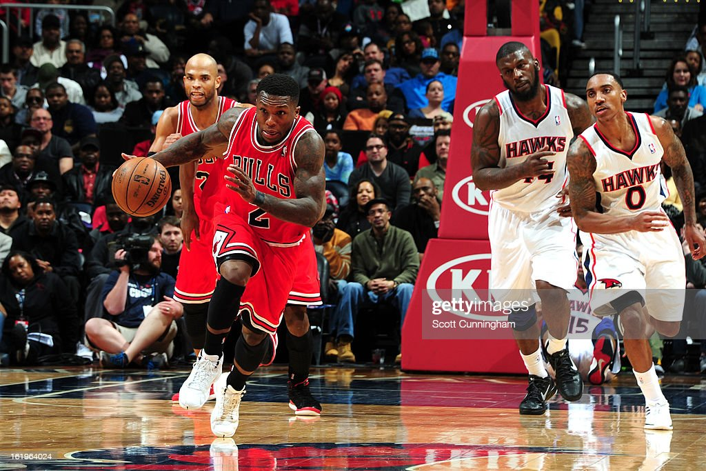 <a gi-track='captionPersonalityLinkClicked' href=/galleries/search?phrase=Nate+Robinson&family=editorial&specificpeople=208906 ng-click='$event.stopPropagation()'>Nate Robinson</a> #2 of the Chicago Bulls brings the ball up court against the Atlanta Hawks on February 2, 2013 at Philips Arena in Atlanta, Georgia.