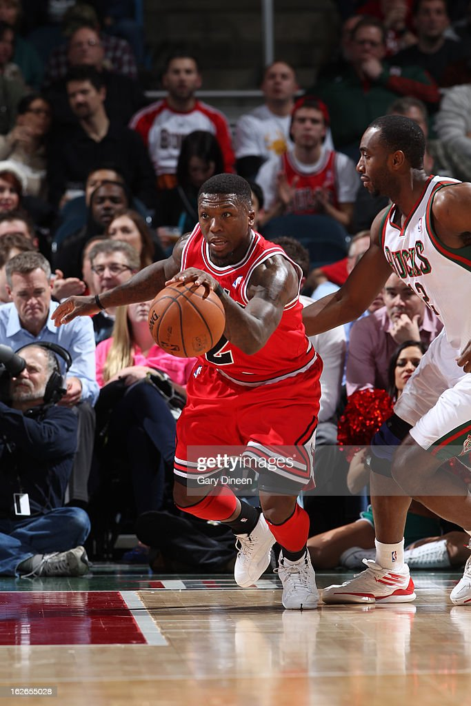 <a gi-track='captionPersonalityLinkClicked' href=/galleries/search?phrase=Nate+Robinson&family=editorial&specificpeople=208906 ng-click='$event.stopPropagation()'>Nate Robinson</a> #2 of the Chicago Bulls brings the ball up court against the Milwaukee Bucks on January 30, 2013 at the BMO Harris Bradley Center in Milwaukee, Wisconsin.