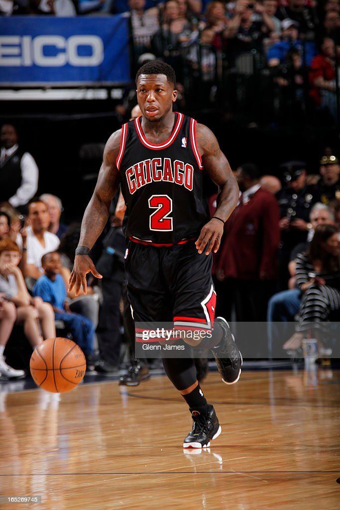 <a gi-track='captionPersonalityLinkClicked' href=/galleries/search?phrase=Nate+Robinson&family=editorial&specificpeople=208906 ng-click='$event.stopPropagation()'>Nate Robinson</a> #2 of the Chicago Bulls brings the ball up court against the Dallas Mavericks on March 30, 2013 at the American Airlines Center in Dallas, Texas.