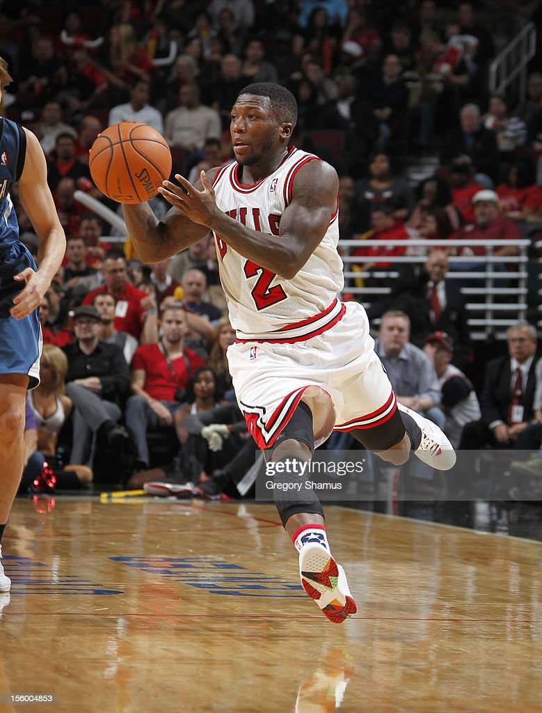 <a gi-track='captionPersonalityLinkClicked' href=/galleries/search?phrase=Nate+Robinson&family=editorial&specificpeople=208906 ng-click='$event.stopPropagation()'>Nate Robinson</a> #2 of the Chicago Bulls brings the ball up court during the game against the Minnesota Timberwolves on November 10, 2012 at the United Center in Chicago, Illinois.