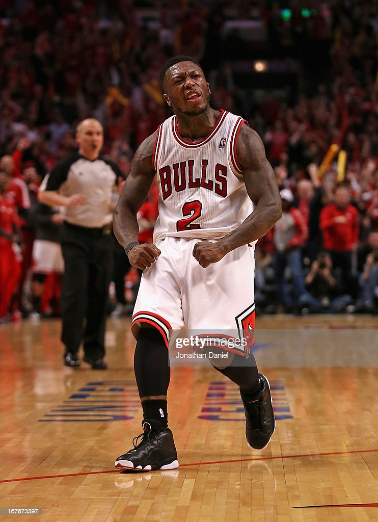 <a gi-track='captionPersonalityLinkClicked' href=/galleries/search?phrase=Nate+Robinson&family=editorial&specificpeople=208906 ng-click='$event.stopPropagation()'>Nate Robinson</a> #2 of the Chicago Bulls celebrates after hitting a shot against the Brooklyn Nets in Game Five of the Eastern Conference Quarterfinals in the 2013 NBA Playoffs at the United Center on April 27, 2013 in Chicago, Illinois. The Bulls defeated the Nets 142-134 in triple overtime.