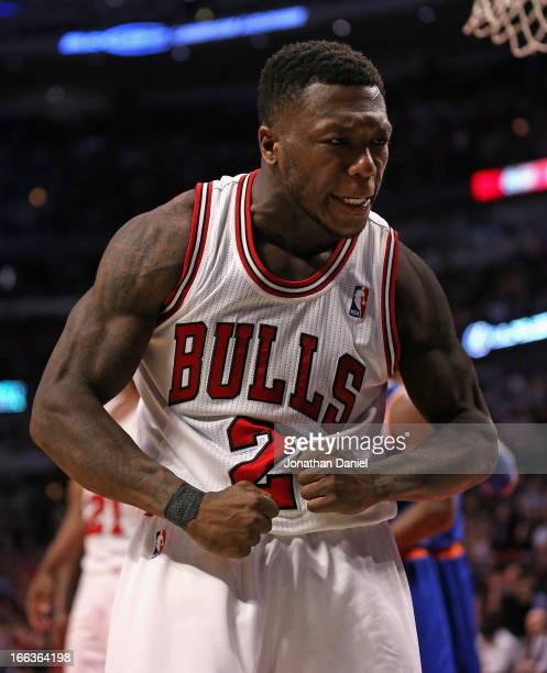 Nate Robinson of the Chicago Bulls celebrates hitting a shot against the New York Knicks at the United Center on April 11 2013 in Chicago Illinois...