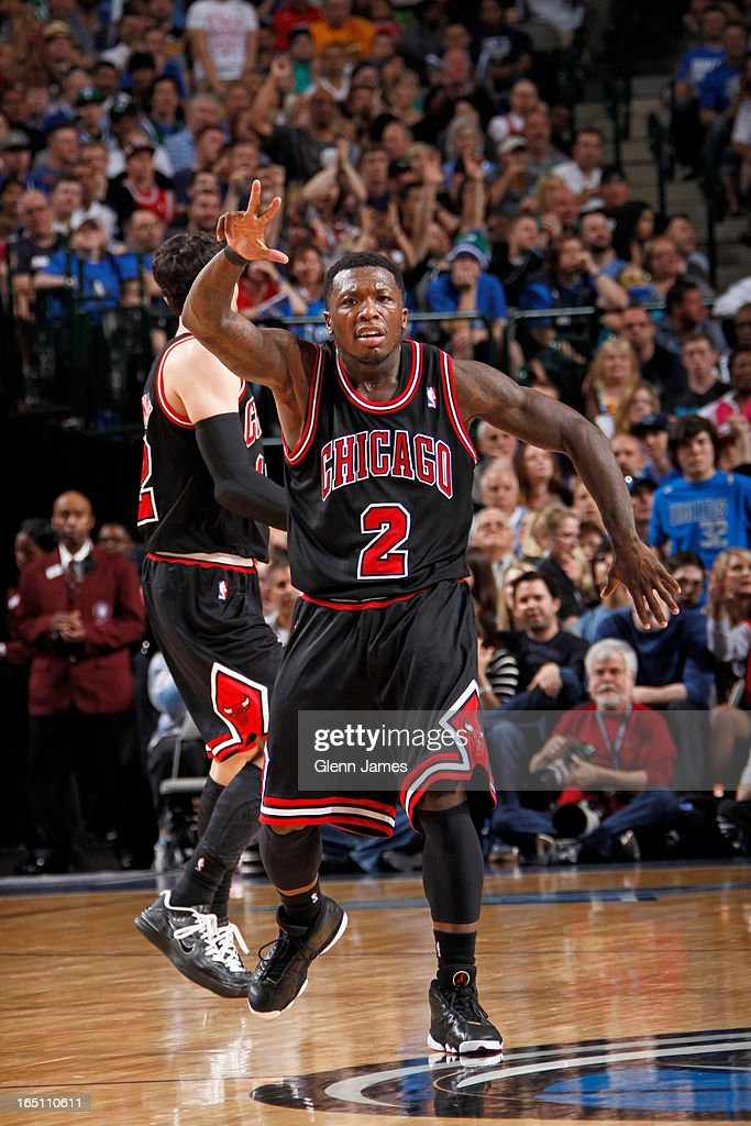 Nate Robinson #2 of the Chicago Bulls celebrates hitting a three pointer against the Dallas Mavericks on March 30, 2013 at the American Airlines Center in Dallas, Texas.