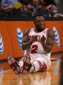 Nate Robinson of the Chicago Bulls celebrates hitting a threepoint shot against the Orlando Magic at the United Center on April 5 2013 in Chicago...