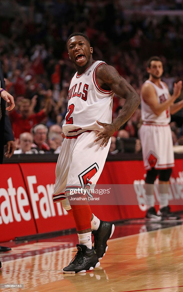 <a gi-track='captionPersonalityLinkClicked' href=/galleries/search?phrase=Nate+Robinson&family=editorial&specificpeople=208906 ng-click='$event.stopPropagation()'>Nate Robinson</a> #2 of the Chicago Bulls celebrates hitting a three-point shot against the New York Knicks at the United Center on April 11, 2013 in Chicago, Illinois. The Bulls defeated the Knicks 118-111 in overtime.