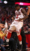 Nate Robinson of the Chicago Bulls celebrates hitting a threepoint shot against the New York Knicks at the United Center on April 11 2013 in Chicago...