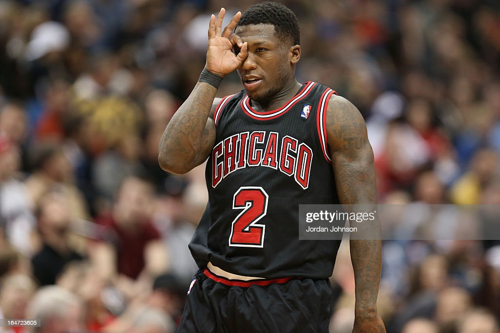 <a gi-track='captionPersonalityLinkClicked' href=/galleries/search?phrase=Nate+Robinson&family=editorial&specificpeople=208906 ng-click='$event.stopPropagation()'>Nate Robinson</a> #2 of the Chicago Bulls celebratesbrates a play against the Minnesota Timberwolves on March 24, 2013 at Target Center in Minneapolis, Minnesota.