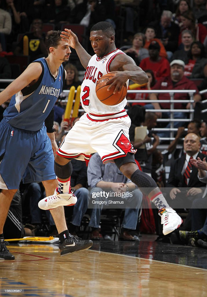 <a gi-track='captionPersonalityLinkClicked' href=/galleries/search?phrase=Nate+Robinson&family=editorial&specificpeople=208906 ng-click='$event.stopPropagation()'>Nate Robinson</a> #2 of the Chicago Bulls controls the ball after being fouled by <a gi-track='captionPersonalityLinkClicked' href=/galleries/search?phrase=Alexey+Shved&family=editorial&specificpeople=5557761 ng-click='$event.stopPropagation()'>Alexey Shved</a> #1 of the Minnesota Timberwolves on November 10, 2012 at the United Center in Chicago, Illinois.