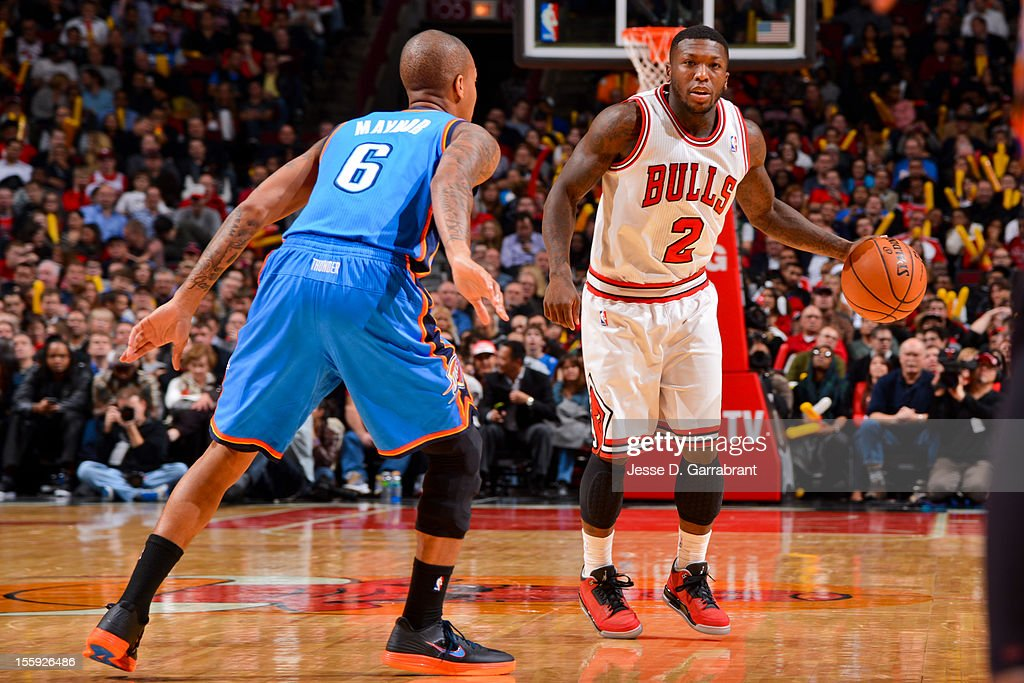 Nate Robinson #2 of the Chicago Bulls controls the ball against Eric Maynor #6 of the Oklahoma City Thunder on November 8, 2012 at the United Center in Chicago, Illinois.