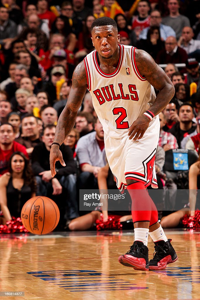 Nate Robinson #2 of the Chicago Bulls controls the ball against the Charlotte Bobcats on January 28, 2013 at the United Center in Chicago, Illinois.