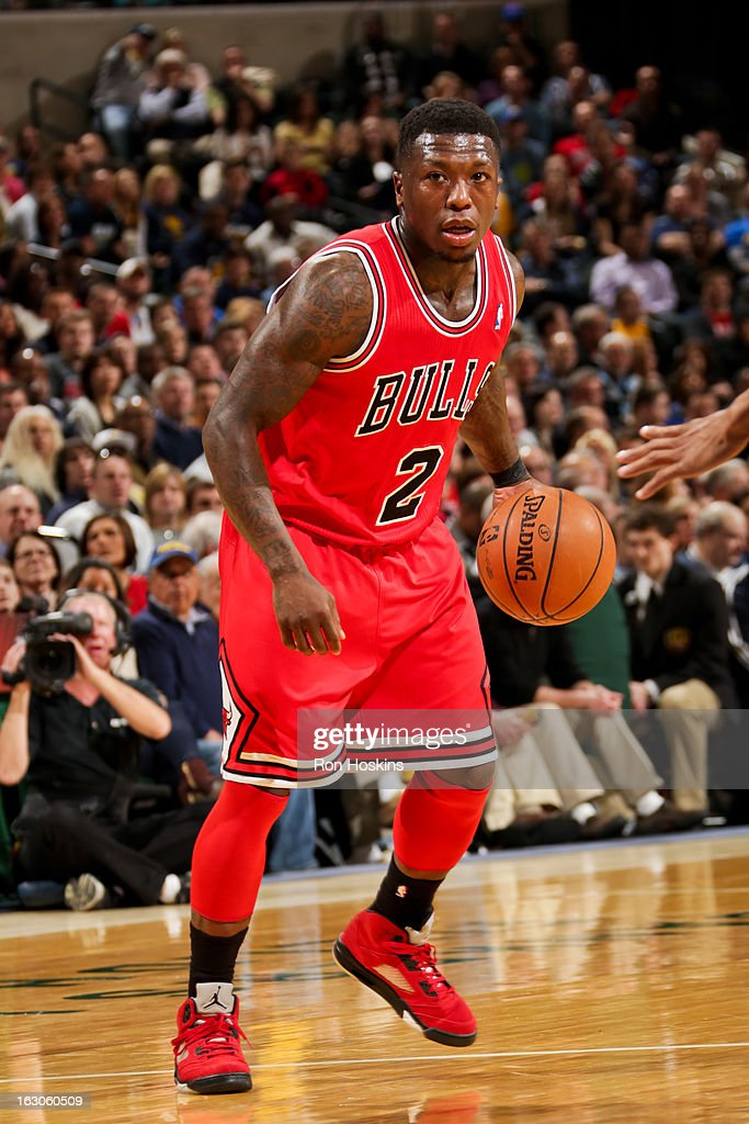 <a gi-track='captionPersonalityLinkClicked' href=/galleries/search?phrase=Nate+Robinson&family=editorial&specificpeople=208906 ng-click='$event.stopPropagation()'>Nate Robinson</a> #2 of the Chicago Bulls controls the ball against the Indiana Pacers on March 3, 2013 at Bankers Life Fieldhouse in Indianapolis, Indiana.