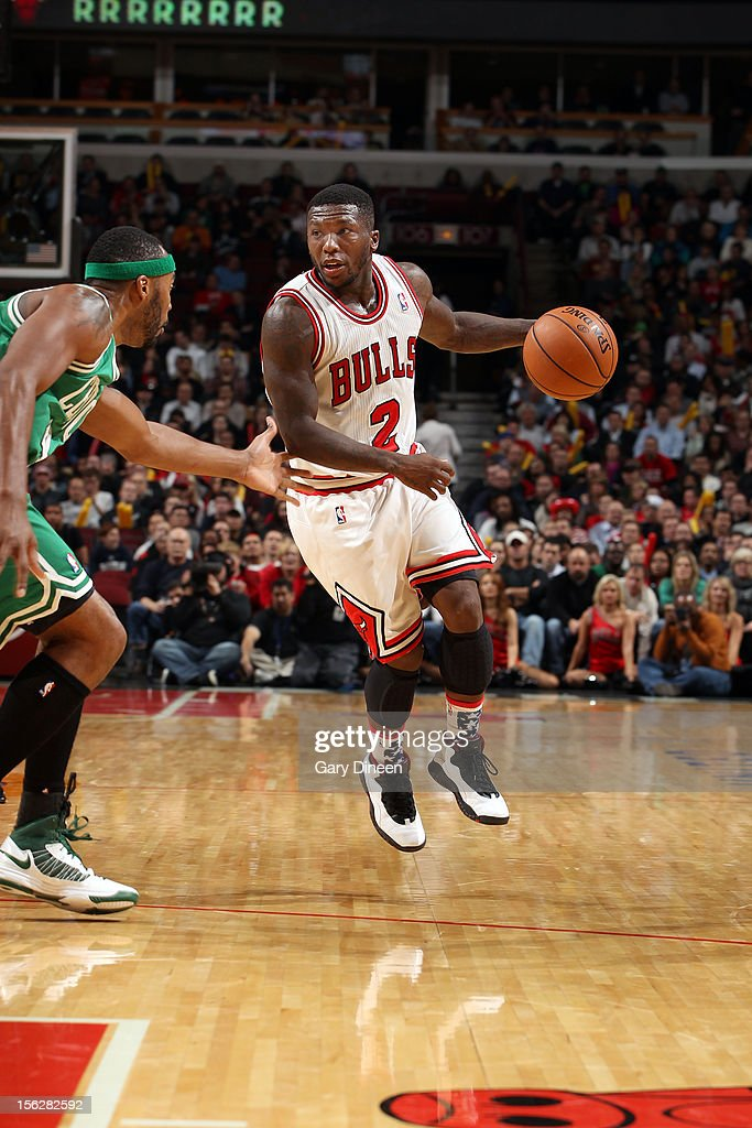Nate Robinson #2 of the Chicago Bulls dribbles against Chris Wilcox #44 of the Boston Celtics during the NBA game on November 12, 2012 at the United Center in Chicago, Illinois.
